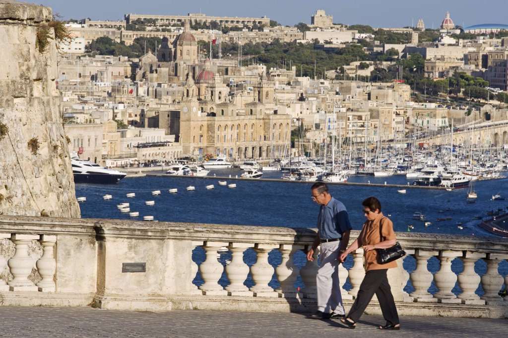 Stock Photo: 4272-21150 Malta, Valletta. An elegant ballustrade on the old walls of Valletta provides a panoramic view over the Grand Harbour towards Vittoriosa.