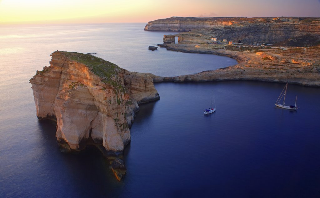 Malta, Gozo, Dwejra; 'Fungus Rock' Named so, because of the plant growing on it. : Stock Photo