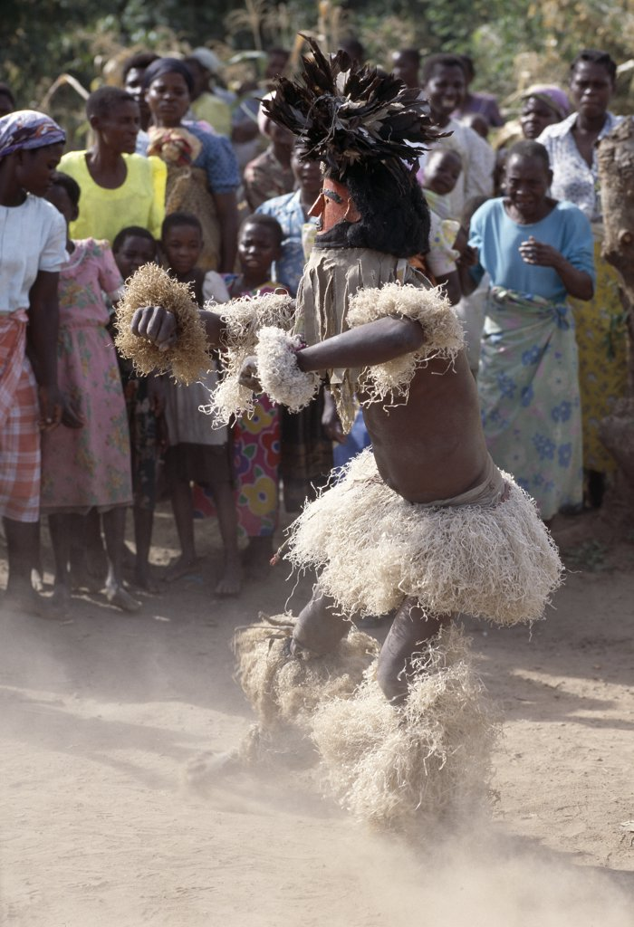 Stock Photo: 4272-22238 The Chewa people, Malawis largest ethnic group, live on the west side of Lake Malawi.  Despite years of missionary influence, they still cling to old beliefs and rituals.  For them, death simply means a journey of rebirth into the spirit world.