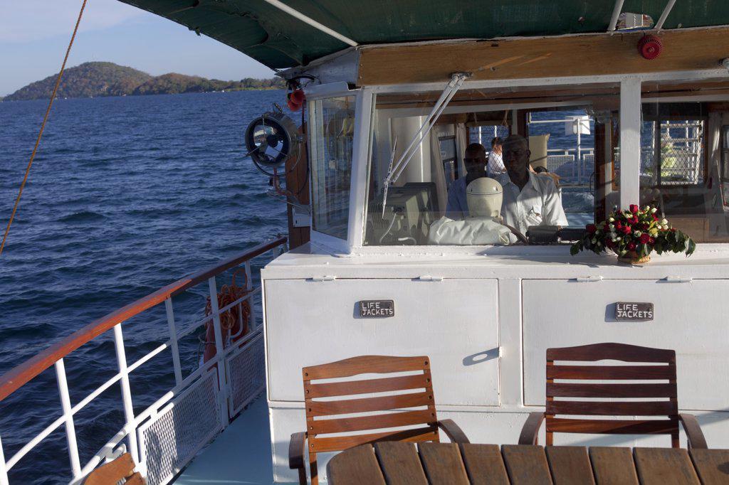 Malawi, Lake Malawi, Club Makokola. Cruising on Lake Malawi in traditional style aboard a passenger boat : Stock Photo