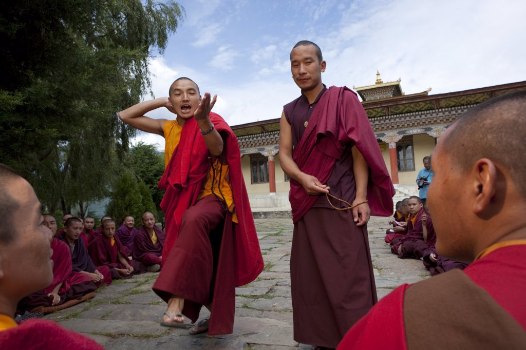 Stock Photo: 4272-2261 Monks debating at the Sangha of the Kharchu Monastery in Chamkar, Bhutan