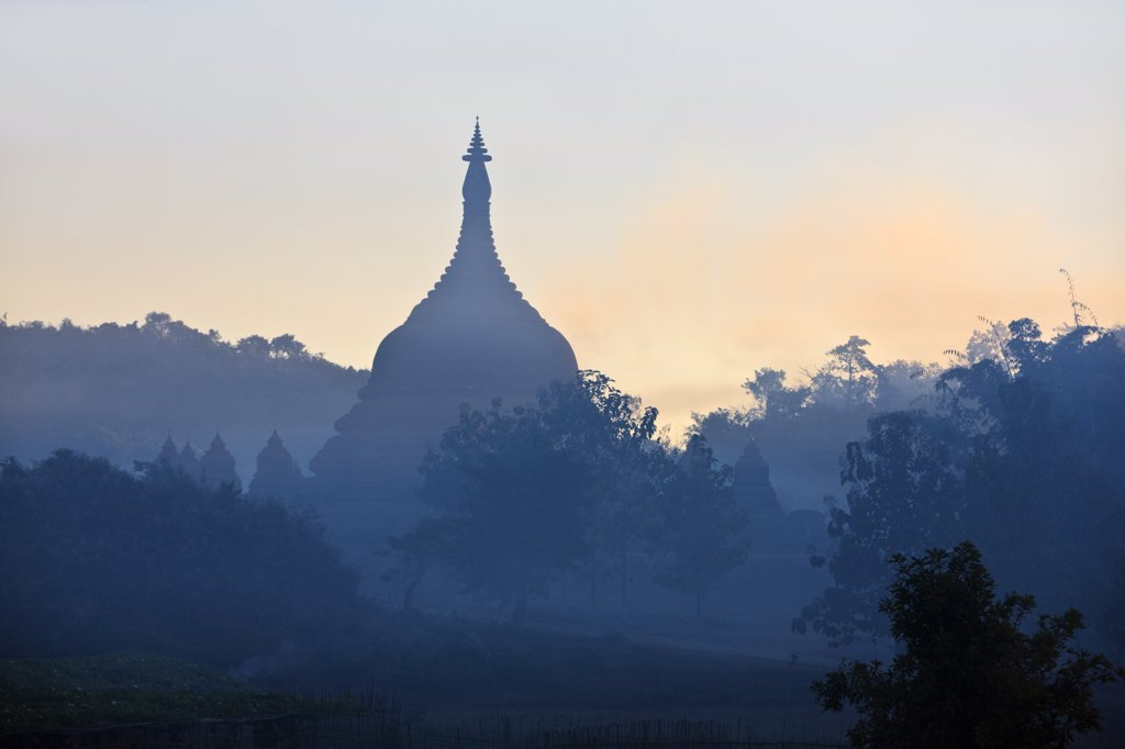 Stock Photo: 4272-22701 Myanmar, Burma, Mrauk U. Dawn mist shrouds the ancient temples, payas and stupas of Mrauk U.