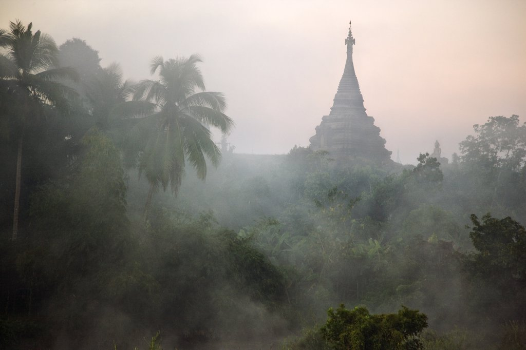 Stock Photo: 4272-22731 Myanmar, Burma, Mrauk U. Early morning mist shrouds an historic temple of Mrauk U built in the Rakhine style between the 15th and 17th centuries.