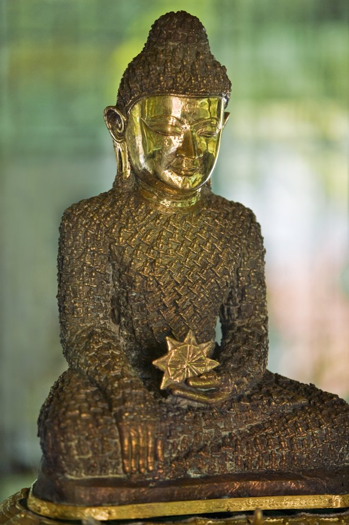Myanmar, Burma, Rakhine State, Sittwe. The 18-inch-high Bronze Buddha at Lawkanandar Pagoda is claimed to be 2,000 years old.  It has clothing made up of 1,162 small Budhha images. : Stock Photo