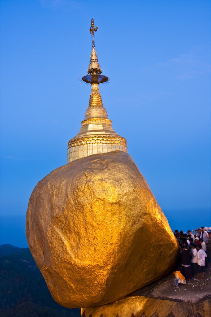 Stock Photo: 4272-22830 Myanmar, Burma, Golden Rock, Kyaiktiyo. The Golden Rock boulder balanced precariously on the edge of Mount Kyaiktiyo.