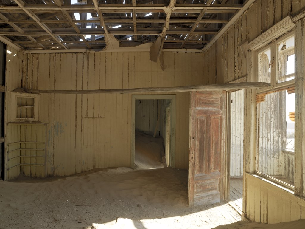 Stock Photo: 4272-23328 A scene in the deserted diamond-mining town of Kolmanskop, which was abandoned more than fifty years ago.  The place is now a ghost town where sand from the surrounding desert has encroached into all the old buildings of this once prosperous place.