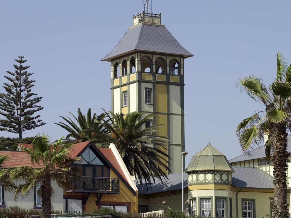 Fine old buildings in Swakopmund depicts the architecture of this seaside town on Namibia's windswept Atlantic coast. The place has a distinctly Teutonic flavour, reflecting the country's colonial past as the Protectorate of German South-West Africa from the late 19th century until the end of the Great War. : Stock Photo