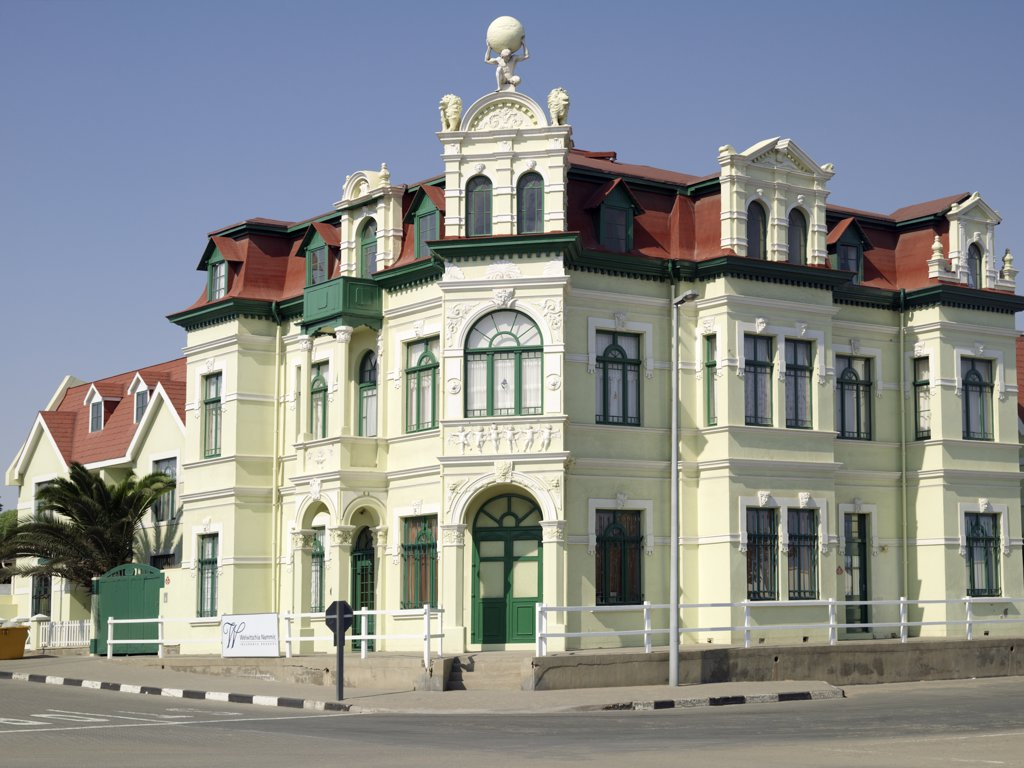A fine old building in Swakopmund depicts the architecture of this seaside town on Namibia's windswept Atlantic coast. The place has a distinctly Teutonic flavour, reflecting the country's colonial past as the Protectorate of German South-West Africa from the late 19th century until the end of the Great War. : Stock Photo