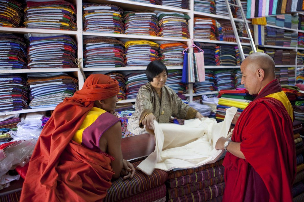 Monks buying cloth in a store in Thimphu, Bhutan : Stock Photo