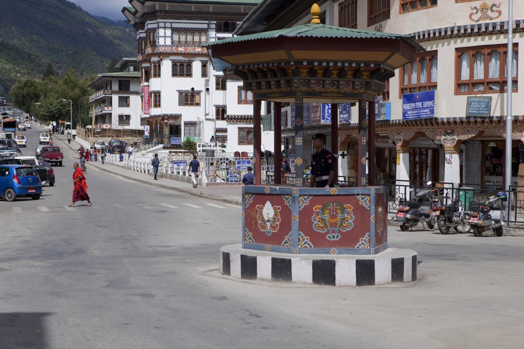 A traffic cop in an intersection in downtown Thimphu Bhutan : Stock Photo