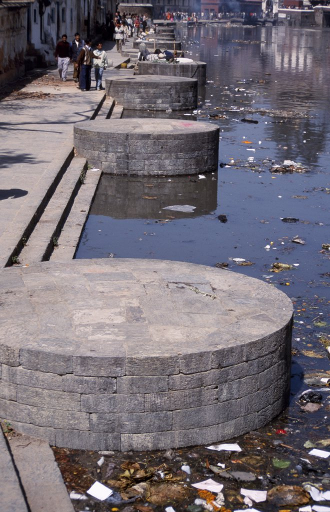 Cremation ghats by the Bagmati River at Pashupatinath temple complex, Kathmandu Valley : Stock Photo
