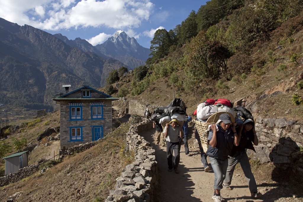 Stock Photo: 4272-23898 Nepal, Everest Region, Lukla, Khumbu Valley. Porters on the Everest Base Camp trail looking down towards the Khumbu Valley