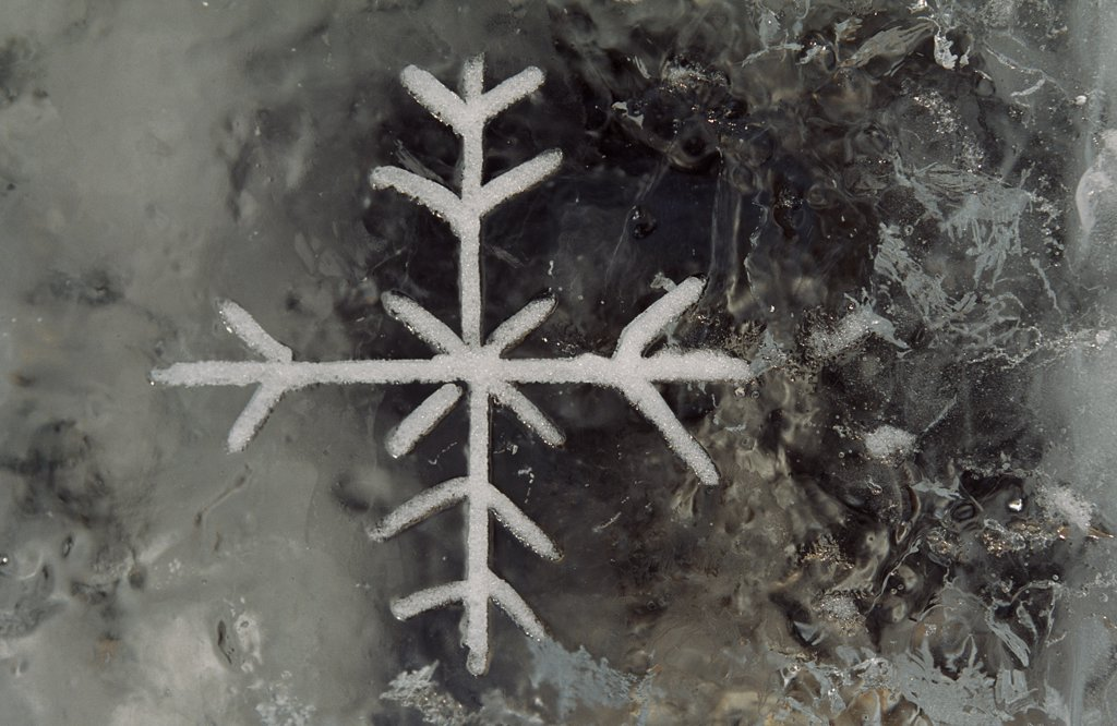 Stock Photo: 4272-24323 Snow flake emblem carved into ice wall at the Alta Ice Igloo Hotel, Alta, Arctic Circle,Northern Norway