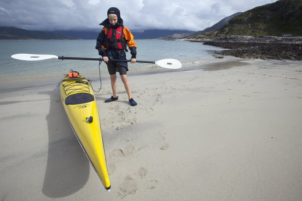 Stock Photo: 4272-24569 Norway, Tromso Region, Island of Somm¡r¡y.   A young boy has his first sea kayaking lesson. (MR)
