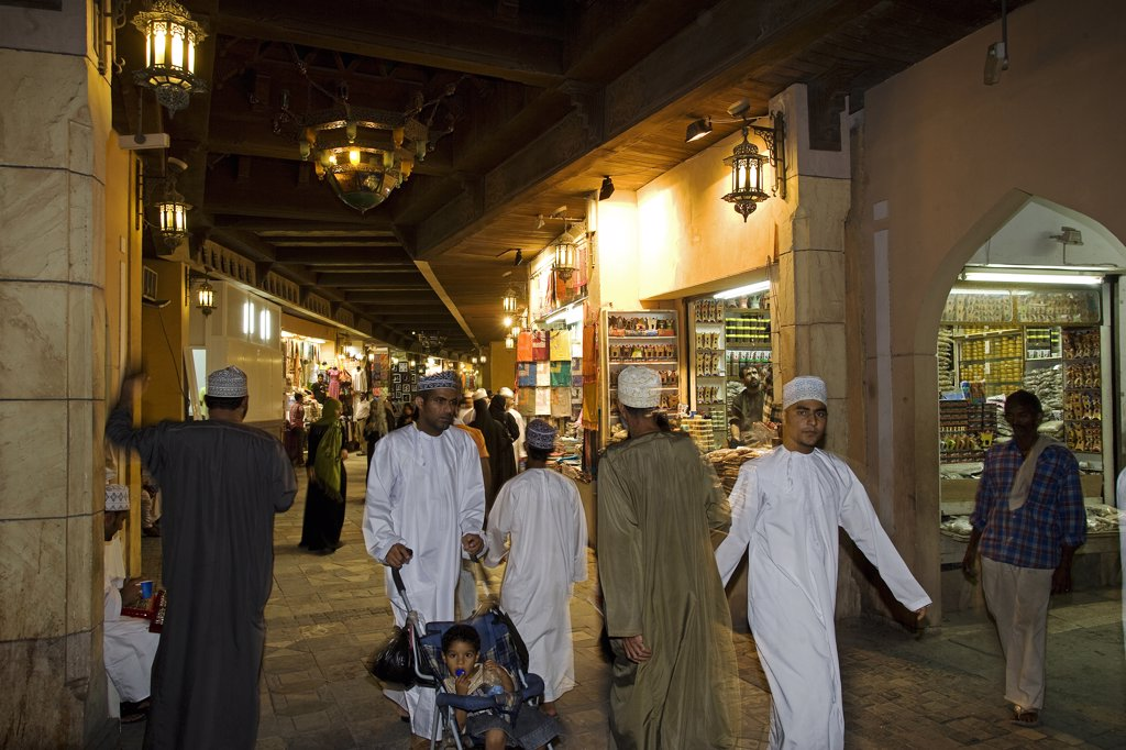 Stock Photo: 4272-25033 Oman, Muscat. The Mutrah Souq area of the country's capital. A traditional bazar, the souq is a warren of alleyways and lined by traditional stalls and a must for visitors to Muscat and locals alike.  The market comes alive in the evening as the heat of the day dissipates.