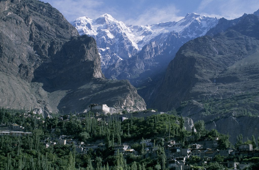 Stock Photo: 4272-25310 In the foreground are the lush orchards of the old town of Baltit and beyond to the north are the Karakorums with the peak of Ultar II visible
