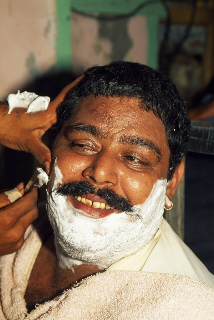Stock Photo: 4272-25344 A close shave: most men in Pakistan visit a barber several times each week.