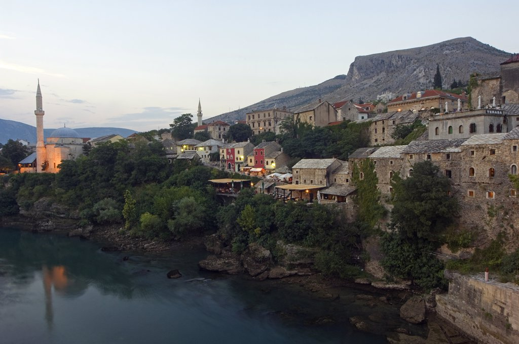 Stock Photo: 4272-2556 Mostar town houses and Koski Mehmed Pasa Mosque (1557) lit up over Neretva River