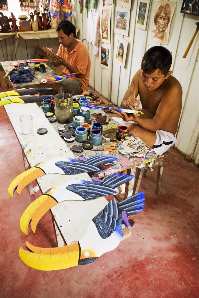 Peru, Amazon, Amazon River. Artist's workshop in Iquitos - carving tropical birds out of balsa wood. : Stock Photo