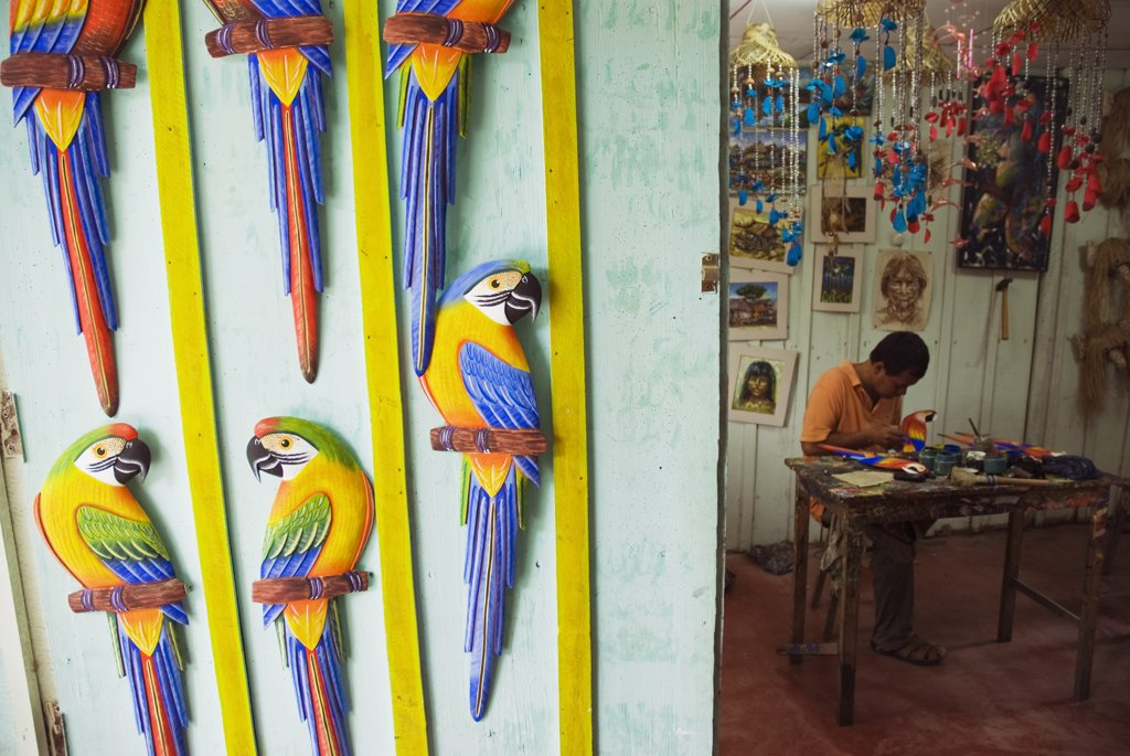 Stock Photo: 4272-25666 Peru, Amazon, Amazon River. Artist's workshop in Iquitos - carving tropical birds out of balsa wood.