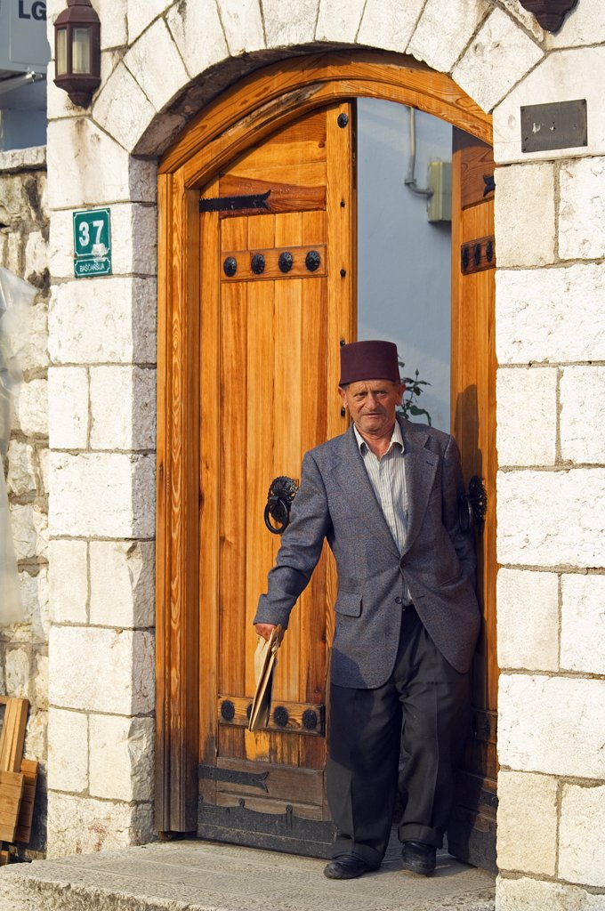 Stock Photo: 4272-2581 Bascarsija Old Turkish Quarter Man wearing Traditional Turkish Fez Hat