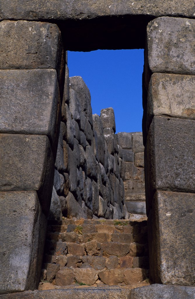 Sacsayhuaman fortress above Cusco is one of the most impressive of all the Inca ruins. The trapezoidal door is classic Inca architecture, built to withstand earthquakes unlike the Spanish arches which frequently tumble down. : Stock Photo