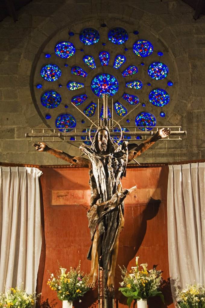 Philippines, Luzon Island, The Cordillera Mountains, Mountain Province, Sagada. St Mary's Episcopal Church - wooden sculptured crucifix of Christ. : Stock Photo