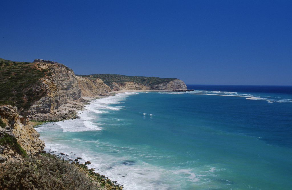 Stock Photo: 4272-26223 Waves beat against the rugged coastline between Salema and Burgau