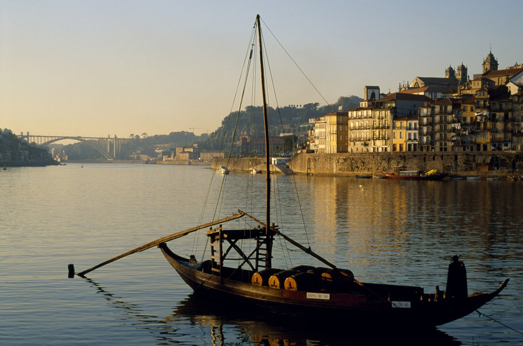 Stock Photo: 4272-26250 Though little used today, a traditional ribeira, or a port wine boat, recalls an age when much of the region's port was transported from estates down the Rio Douro.
