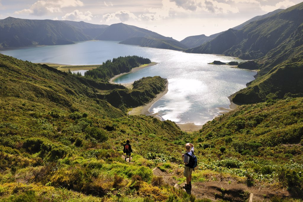 Stock Photo: 4272-26589 A couple walking along the big volcanic crater of Lagoa do Fogo (Fire Lagoon), a nature reserve and one of the most preserved sites in Sao Miguel. Azores islands, Portugal