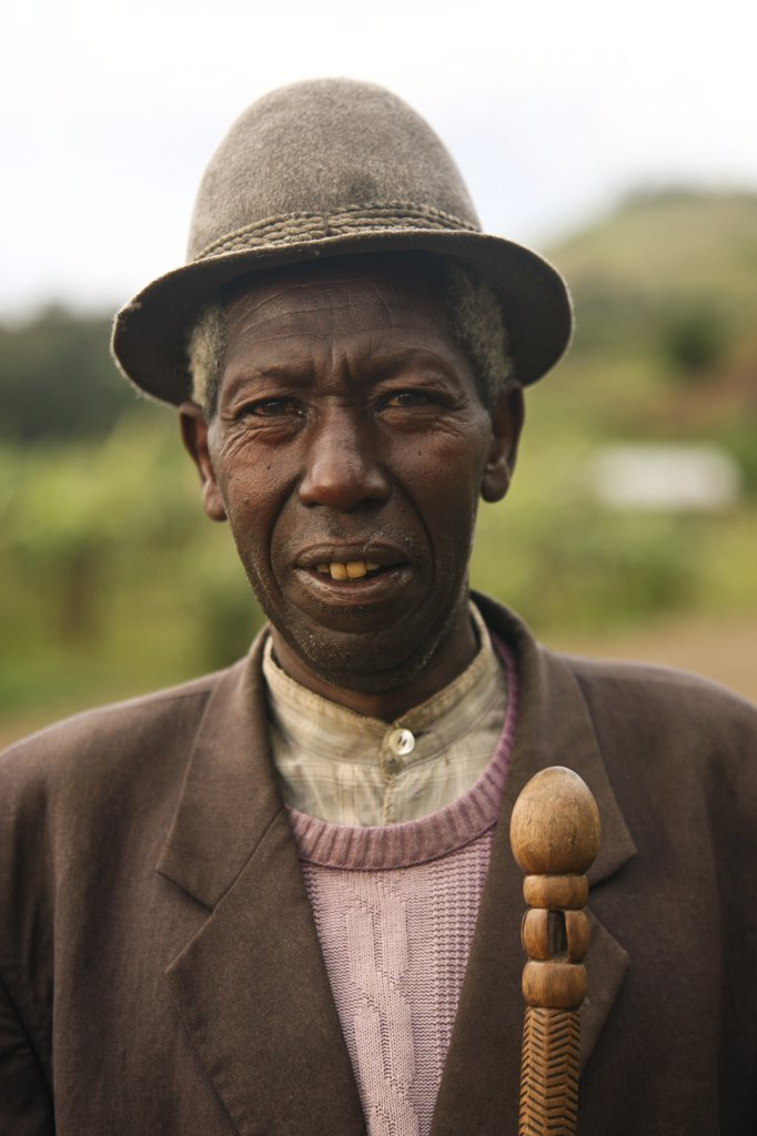Gisenyi, Rwanda. A local elderly man walks to the market in Gisenyi. : Stock Photo