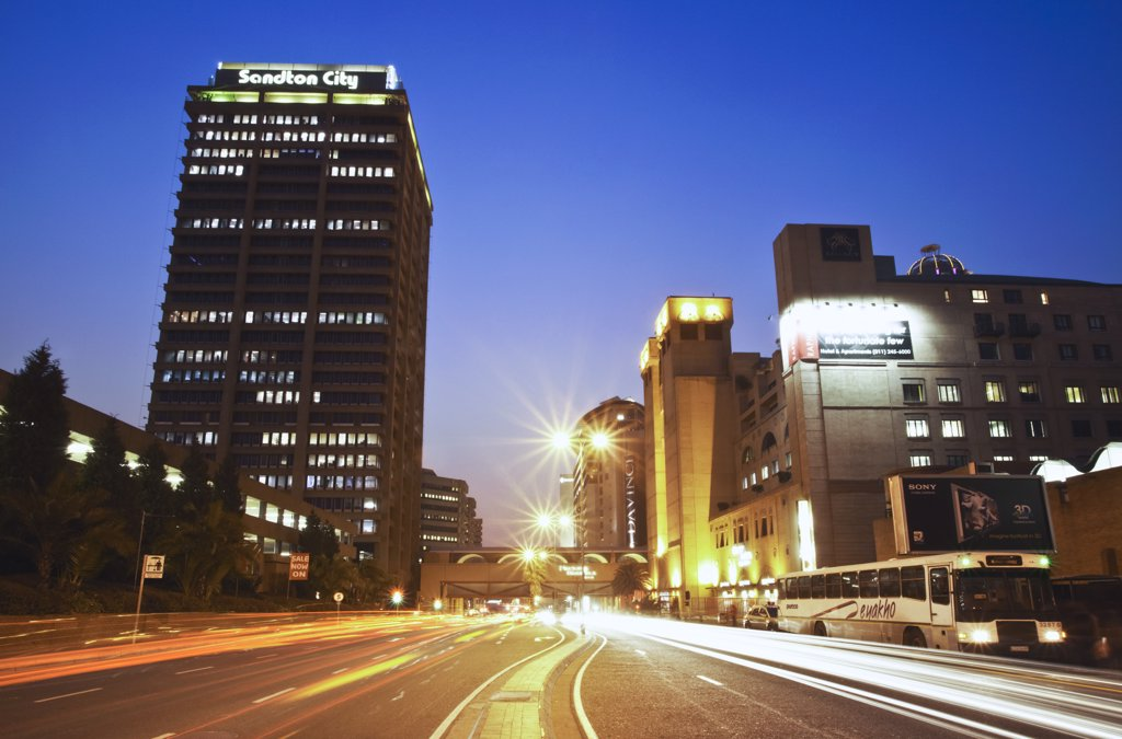 Light trails of traffic passing through downtown Sandton, Johannesburg, Gauteng, South Africa : Stock Photo