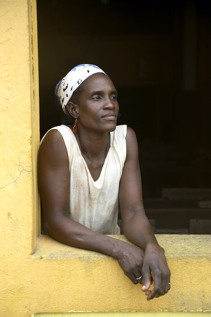 Stock Photo: 4272-28674 A Sao Tomense woman at the cocoa plant where she works in the small village of Agua Ize in Sao Tome and Principe. Sao Tome and Principe is Africa's second smallest country with a population of 193 000. It consists of two mountainous islands in the Gulf of New Guinea, straddling the equator, west of Gabon.