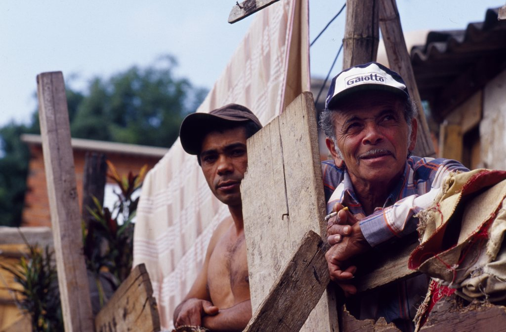 Stock Photo: 4272-2971 A father and son looking out from their home in Sao Paulo.
