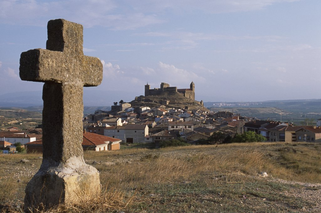Stock Photo: 4272-29931 The hilltop village of San Vicente seen from one of the stone crosses that represent the Twelve Stations of the Cross.  San Vicente is known for its guild of flagellants who process along the stations of the cross whipping themselves in penance as they go.