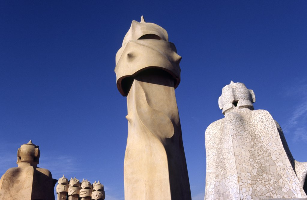 The surreal chimneys of Antoni Gaudi's architectural icon, Casa Mila in Barcelona. Known as La Pedrera (the Quarry), the builiding was built between 1905-1911 during the period of modernisme. : Stock Photo