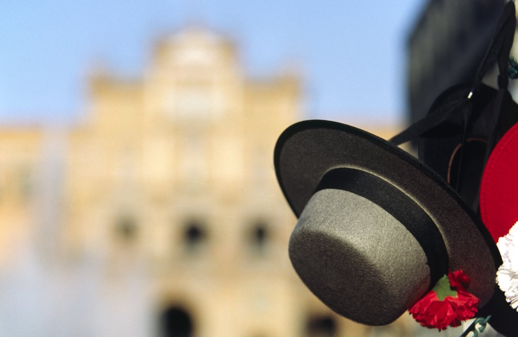 Stock Photo: 4272-30244 A Spanish gaucho hat hangs in front of the Plaza de Espana in Seville