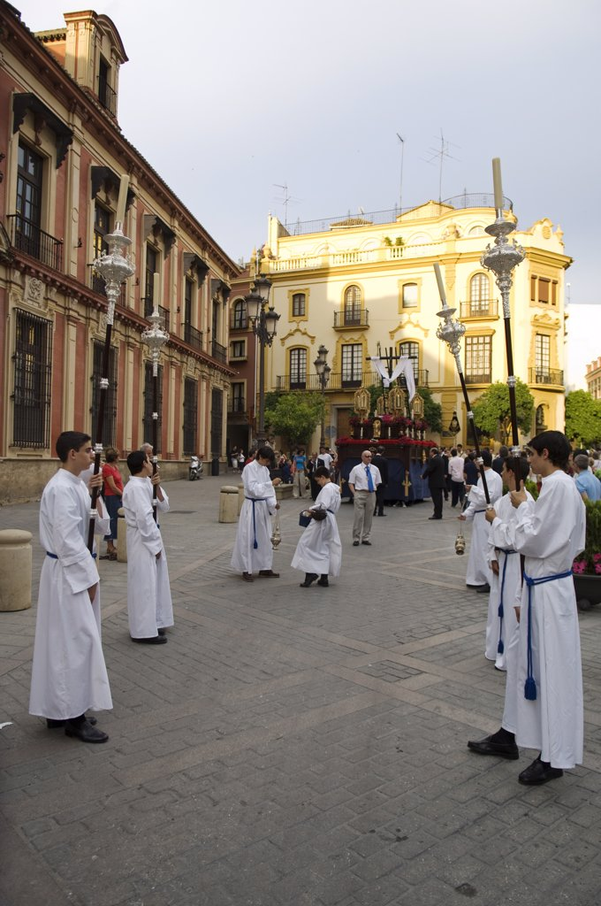 Stock Photo: 4272-30313 Spain, Andalucia, Seville. Acolytes carry candles through the streets during a procession by one of the Catholic brotherhoods of Seville.