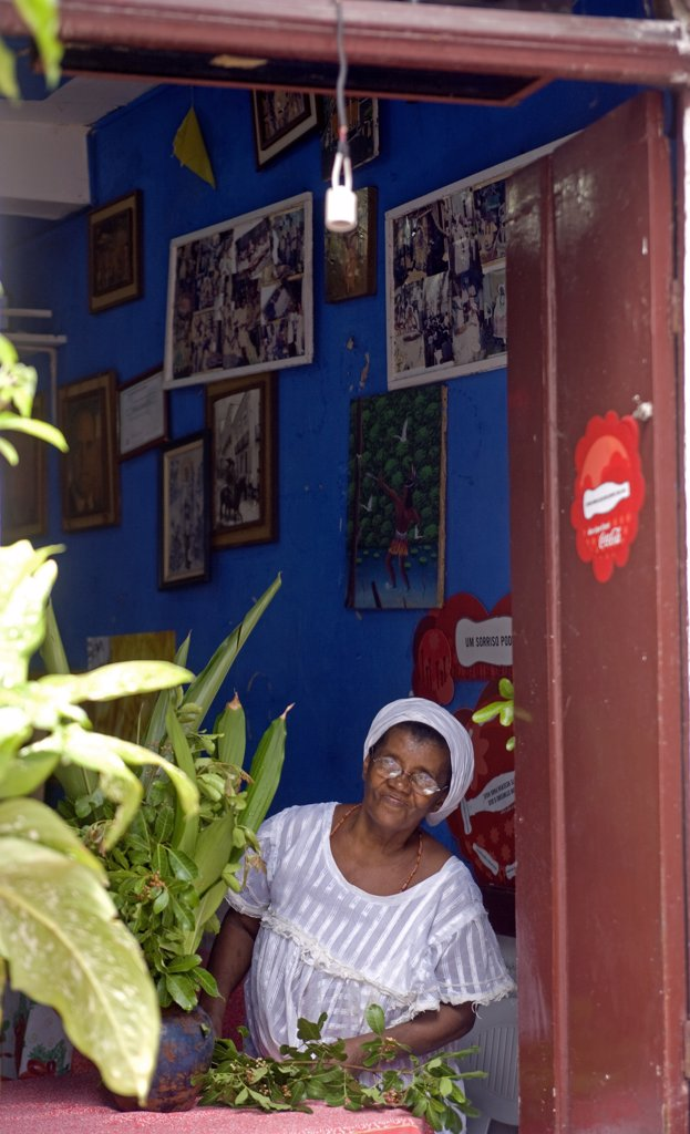 Cafe owner looks into the street in the UNESCO city of Salvador da Bahia, North East Brazil : Stock Photo