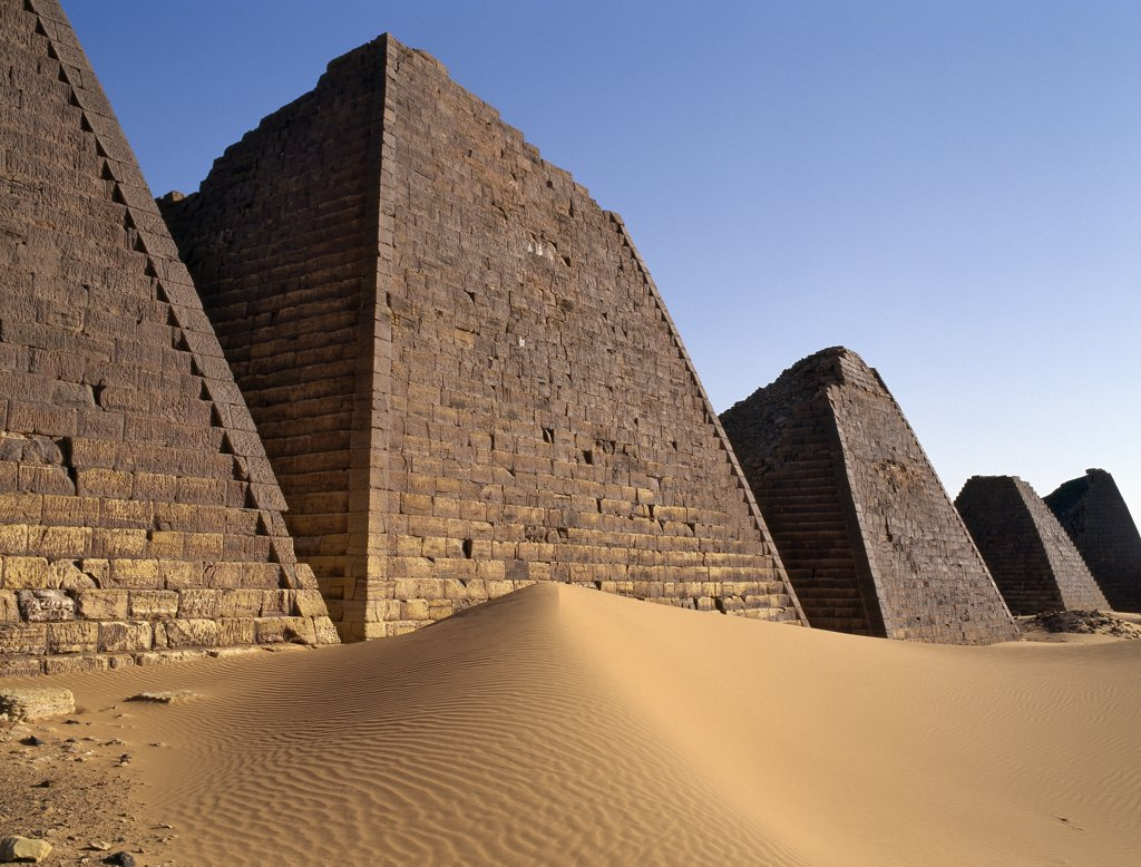 Situated a short distance east of the Nile, the ancient pyramids of Meroe are an important burial ground of thirty kings, eight queens and three princes of the Kingdom of Cush who reigned during the Afro Egyptian Meroitic period roughly between 300BC and 300AD. : Stock Photo