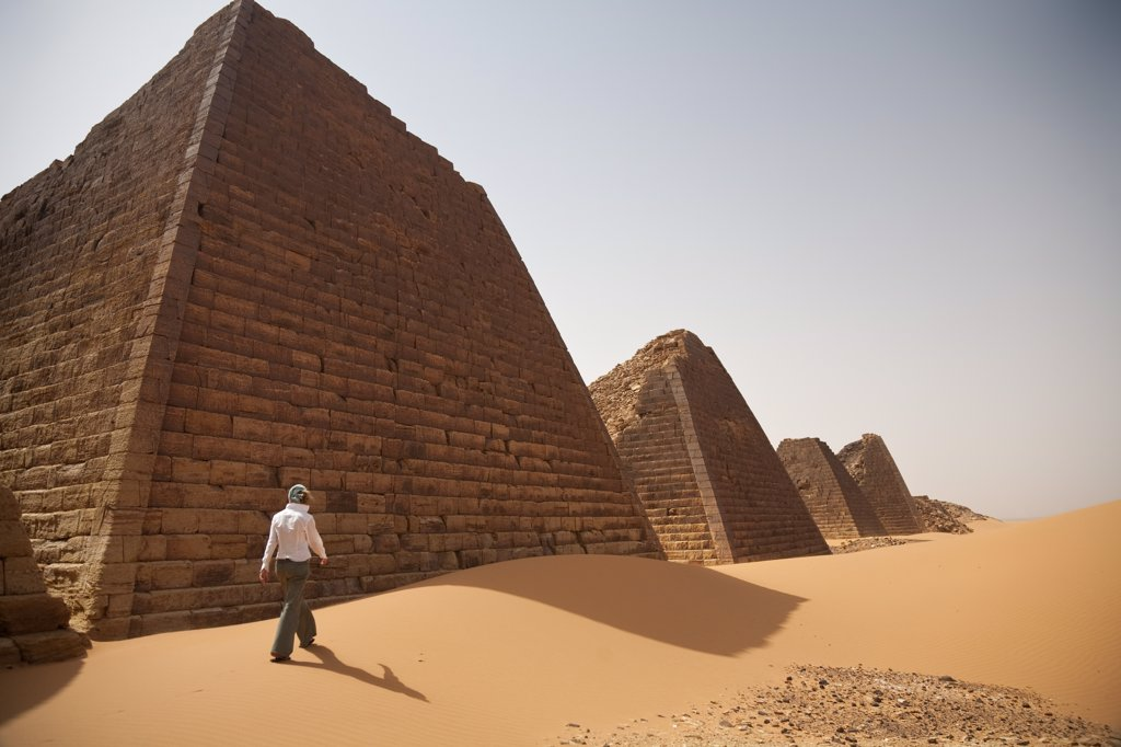 Stock Photo: 4272-31345 Sudan, Begrawiya. A tourist explores the ancient Nubian Pyramids.