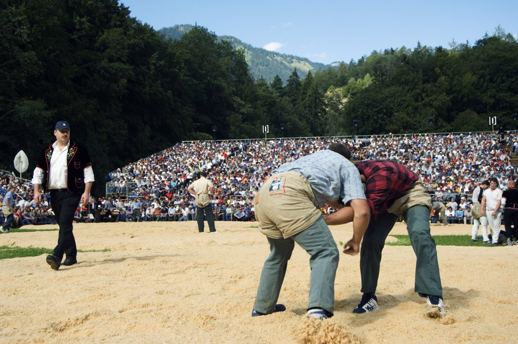Alpine wrestling at the Unspunnen Bicentenary Festival, a traditional mountain and alpine competition, Interlaken, Jungfrau Region, Switzerland : Stock Photo