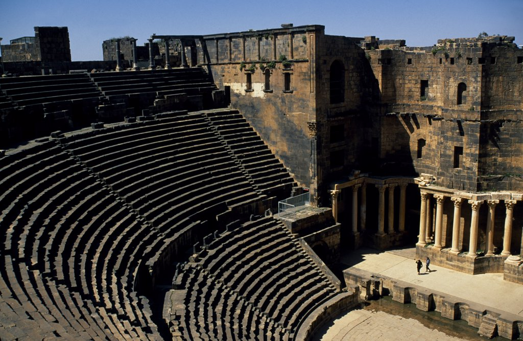 Stock Photo: 4272-31724 Originally built by the Romans, Bosra's 15,000 seat amphitheatre was gradually fortified from the 7th century on by successive Arab dynasties; it remains among the best preserved Roman theatres.