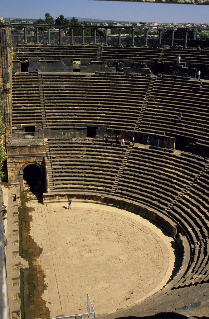 Originally built by the Romans, Bosra's 15,000 seat amphitheatre was gradually fortified from the 7th century on by successive Arab dynasties; it remains among the best preserved Roman theatres. : Stock Photo