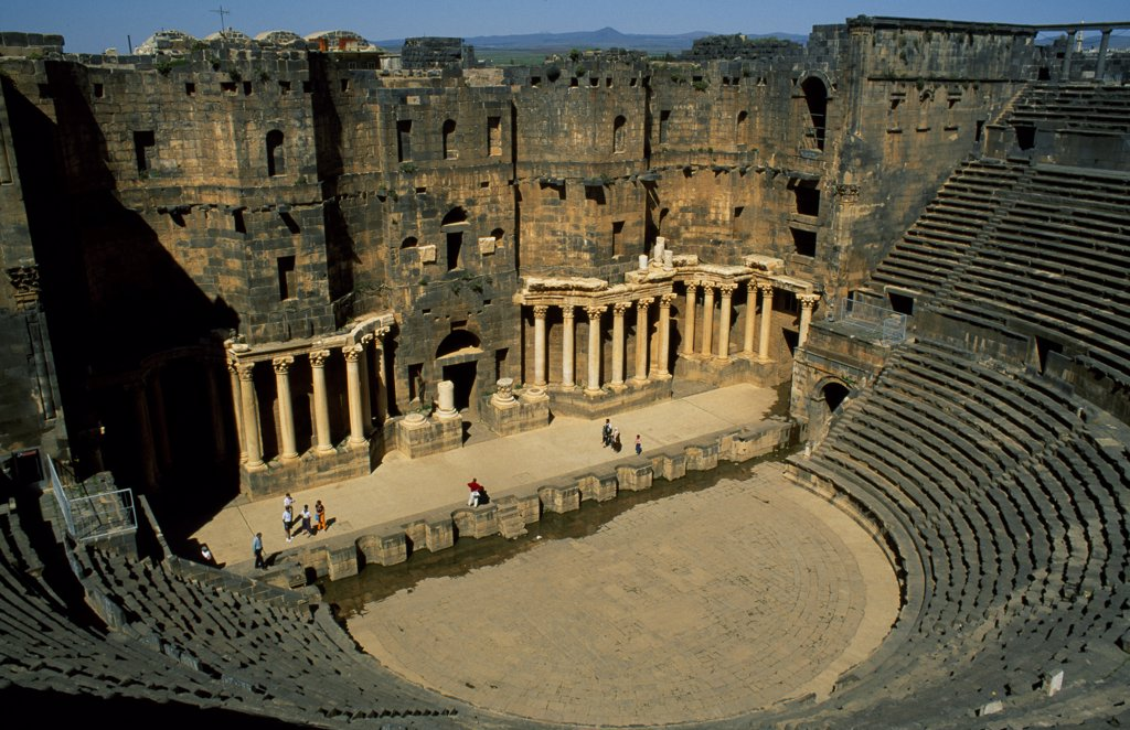 Stock Photo: 4272-31726 Originally built by the Romans, Bosra's 15,000 seat amphitheatre was gradually fortified from the 7th century on by successive Arab dynasties; it remains among the best preserved Roman theatres.
