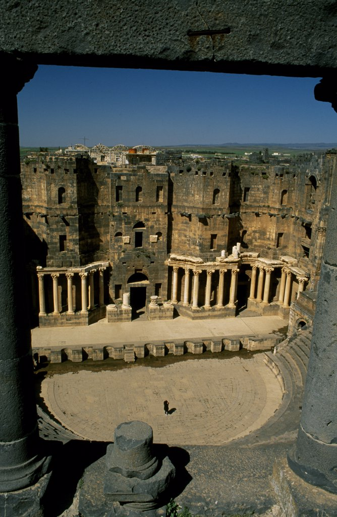 Stock Photo: 4272-31727 Originally built by the Romans, Bosra's 15,000 seat amphitheatre was gradually fortified from the 7th century on by successive Arab dynasties; it remains among the best preserved Roman theatres.