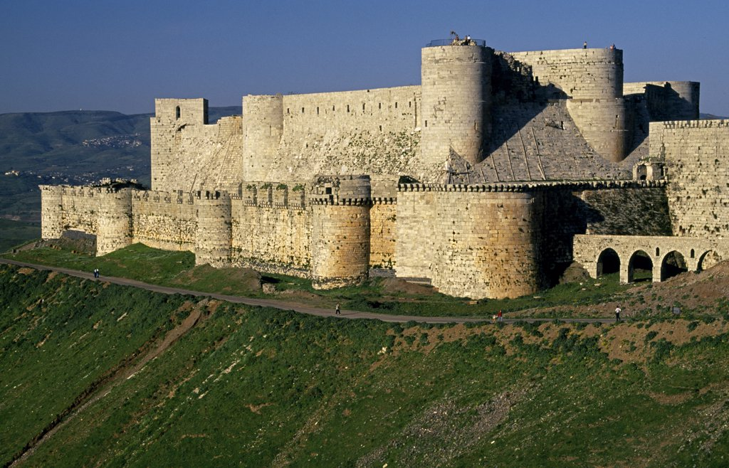 Probably the most celebrated of Crusader castles, the 12th century fortress, Krak des Chevaliers [aka Qalaat al-Husn], was built by the Knights Hospitaller  and occupied a prime strategic position. : Stock Photo