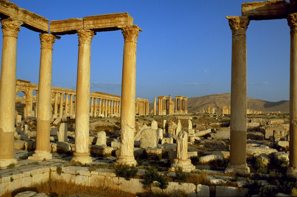 Stock Photo: 4272-31749 Pillars of the 'Great Colonnade' stretch into the distance at Palmyra [aka Tadmor], a deserted city that despite Roman and Greek influences remained largely independent of Rome until its downfall in 273 AD.