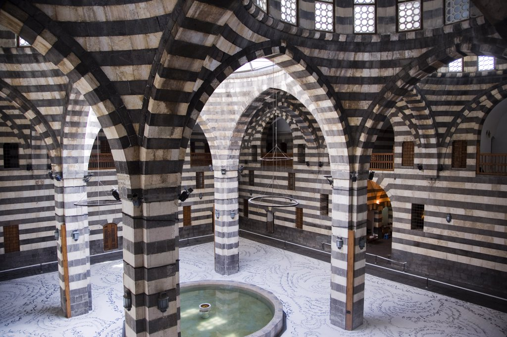 The Khan Asad Pasha, built in 1752, used to house merchants and their shops. It is now the principle exhibition space in the Old City, Damascus, Syria, : Stock Photo