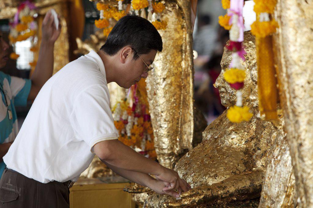 Stock Photo: 4272-32209 Bangkok, Thailand. Praying at a buddhist temple